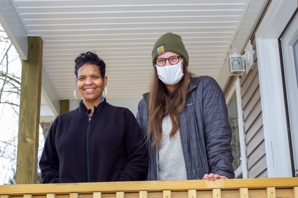Stephanie Bego, left, and Julie Thompson of Appalachian Service Project, stand on the porch of Bego's new home on Charleston's West Side. The home was funded, in part, through the Home4Good program – a partnership between Federal Home Loan Bank Pittsburgh and the West Virginia Housing Development Fund.